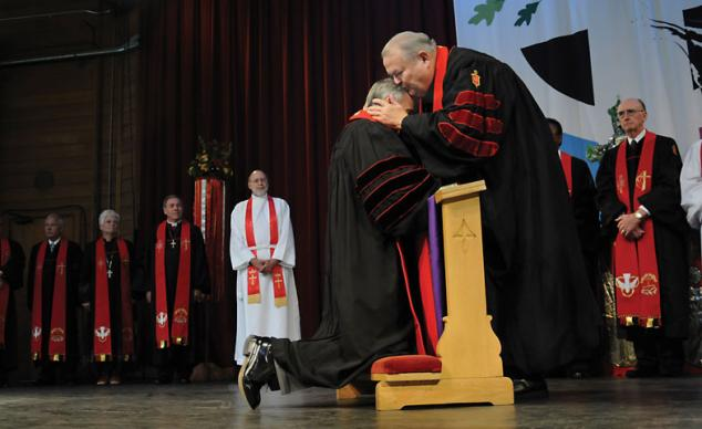 Bishop Marion Edwards kisses newly elected Bishop Paul Leeland during the Southeastern Jurisdictional Conference's service of consecration in 2008. Edwards died in 2011. The five U.S. jurisdictions will elect 15 new bishops and assigned its new and continuing bishops July 13-16, 2016. File photo by Bill Norton, UMNS