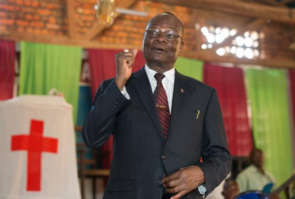 Bishop Gabriel Yemba Unda greets visitors to a choral concert at the Tokolote Moto-Moto United Methodist Church in Kindu, Democratic Republic of Congo, in 2015. File photo by Mike DuBose, UMNS