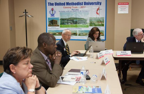 A recent roundtable meeting about the new United Methodist University of Sierra Leone brought together the Rev. Kim Cape (far left), top executive of the United Methodist Board of Higher Education and Ministry, Bishop John Yambasu (second from left) and other church leaders. The university is to open in October. Photo by Jan Snider, UMNS