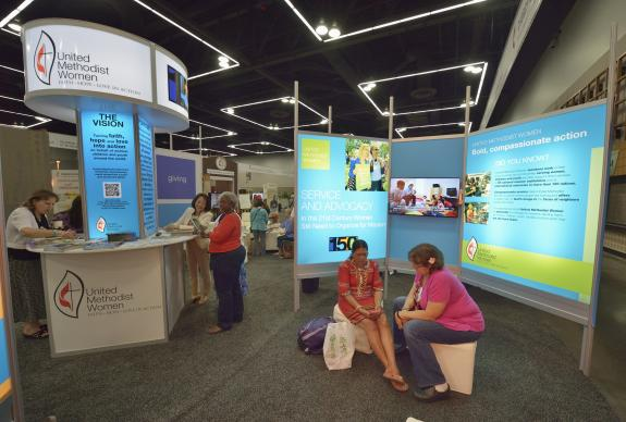 Women visit the display for United Methodist Women in the Exhibit Hall of the 2016  United Methodist General Conference in Portland, Ore. UMW Day will be observed on May 16. Photo by Paul Jeffrey, UMNS.