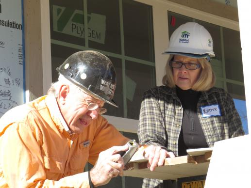 Wayne Chaffin has volunteered on 100 Habitat for Humanity houses built by Highland Park United Methodist Church's Carpenters for Christ group during the last 20 years. On Jan. 27, he and Kathy Adams worked together as the 100th house neared completion in time for the Dallas church's centennial celebration. Photo by Sam Hodges, UMNS