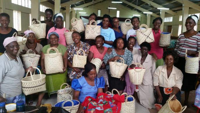 Workshop participants display baskets that they beaded during a workshop held by the Chitungwiza-Marondera District women's union. Photo by Eveline Chikwanah, UMNS