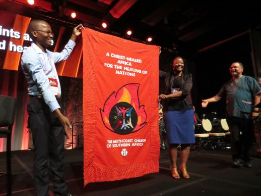 A parade of banners from Methodist and other Wesleyan denominations around the world was a highlight of the Aug. 31 opening worship service at the World Methodist Conference in Houston. Photo by Sam Hodges, UMNS
