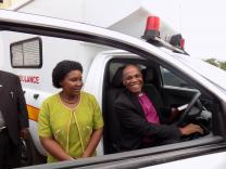 Bishop Eben Nhiwatiwa dedicates a new ambulance for Old Mutare Mission Hospital at the Zimbabwe East Annual Conference meeting. Hospital administrator Monica Nzarayebani looks on. Photo by Priscilla Muzerengwa, UMNS