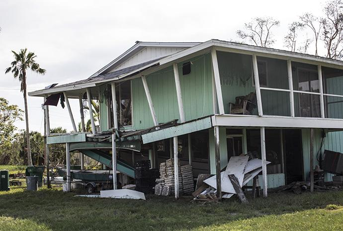 A home in Everglades City, Fla., tilts precariously following damage by Hurricane Irma. Photo by Kathleen Barry, UMNS.