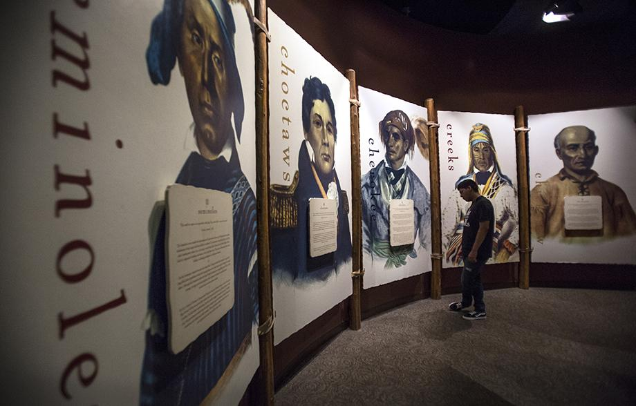 Mika Sam, 15, studies a display of Native American leaders inside the Museum of the Cherokee Indian in Cherokee, N.C.  A member of the Choctaw tribe, he attends Great Spirit United Methodist Church in Bogue Chitto, Miss. Photo by Kathleen Barry, UMNS.