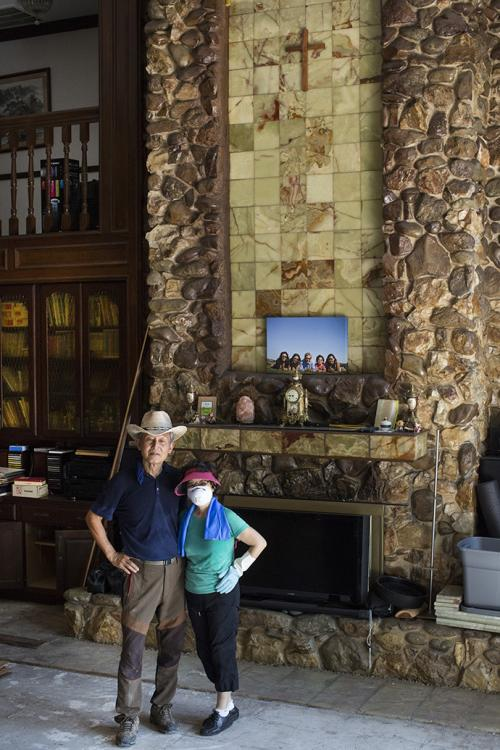 Dan and Grace Cho stand by the fireplace of their Houston home, which flooded following Hurricane Harvey and the release of water from a nearby reservoir. Photo by Kathleen Barry, UMNS.