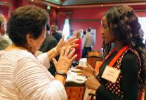 Connectional Table members Josephine Deere of Oklahoma, left, and Miracle Oscan of Malawi discuss the connections among different parts of The United Methodist Church during an icebreaking exercise. The Connectional Table, meeting in Oslo, Norway, approved a plan that ties agency evaluation to the denomination's budget. Photo by Heather Hahn, UMNS.