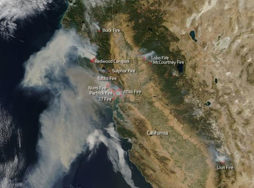 NASA's Aqua satellite natural-color image taken Oct. 9, shows actively burning areas of California (hot spots), detected by MODIS's thermal bands, outlined in red. Wildfires in northern California have burned through nearly 170,000 acres, killing 23, destroying 3,500 homes and other structures, and forcing the evacuation of more than 20,000. Hundreds remain missing. NASA image courtesy of Jeff Schmaltz, LANCE/EOSDIS MODIS Rapid Response Team, GSFC.