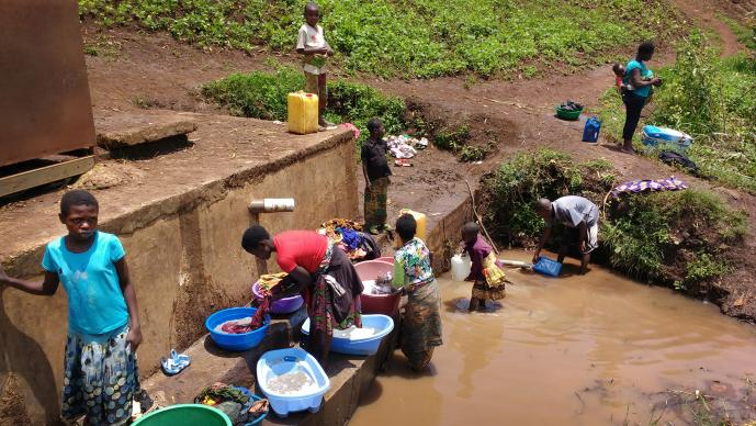 Women and children gather water at a watering point in the Irambo District of Bukavu, Democratic Republic of Congo. A cholera epidemic was declared in the South Kivu Province in August and continues today. Photo by Philippe Kituka Lolonga, UMNS