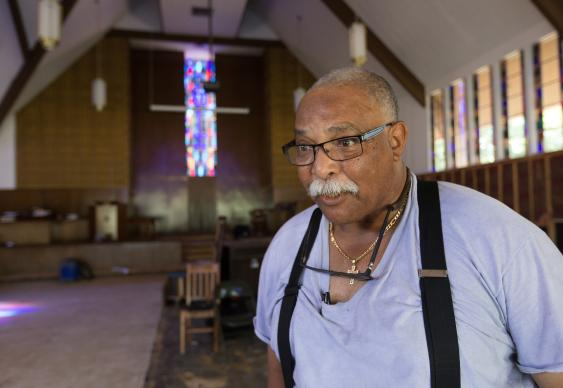 The Rev. H. Louis Jones takes a break from gutting flood-damaged drywall and pews at Hope Community United Methodist Church in Baton Rouge, La. Photo by Mike DuBose, UMNS.