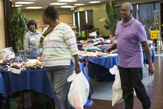 Winita and Larry Young, Hurricane Harvey flood victims, find donated clothing at Windsor United Methodist Church in Houston. Photo by Kathleen Barry, UMNS.