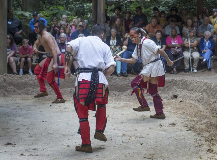 An audience (including conference attendees) watches a reenactment at the Oconaluftee Indian Village in Cherokee, N.C. Photo by Kathleen Barry, UMNS.