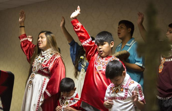 Members of the Choctaw tribe from Mississippi sing in different languages. Photo by Kathleen Barry, UMNS.