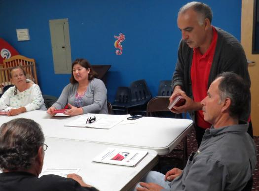 Carlos Gonzalez (standing) of the nonprofit Academia América leads a U.S. citizenship class at La Trinidad United Methodist Church in San Antonio. The class members have legal status, but some say they're worried anyway given President Trump's more aggressive approach on immigration policy. Photo by Sam Hodges, UMNS.