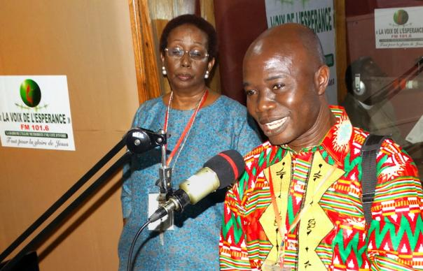 Edward Lahai Massaquoi from Liberia shares his joy about having the support of a United Methodist Radio Network for the United Methodist radio station in Liberia during a live interview at Radio La Voix De l'esperance in Abidjan, Côte D'Ivoire. Lydie Acquah, coordinator for the network, listens to Massaquoi. Photo by Phileas Jusu, UMNS.