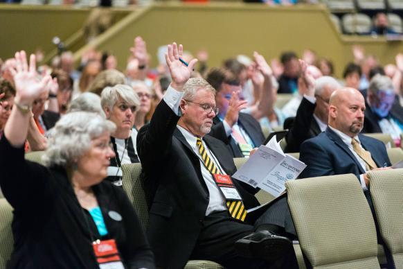 Members participate in the Alabama-West Florida Annual Conference in Montgomery, Ala., including the Revs. Nancy Watson (front row, left), Doug Pennington and Allen Newton. The conference was one of 17 that approved a resolution related to welcoming migrants. Photo by Luke Lucas, Alabama-West Florida Conference.