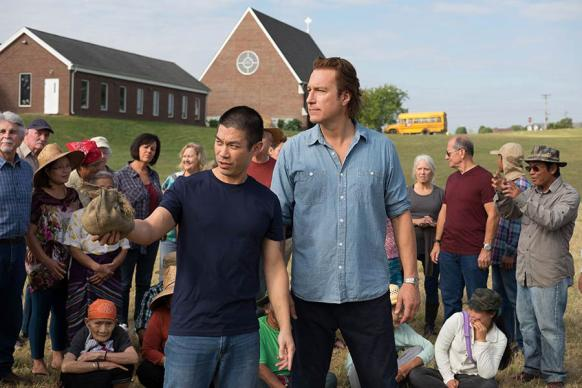 "Ye Win (played by Nelson Lee) and the Rev. Michael Spurlock (played by John Corbett) talk about the work of All Saints' Episcopal Church in the new movie ""All Saints."" Photo courtesy of Sony."
