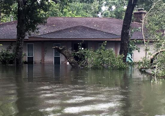 Floodwaters from Tropical Storm Harvey engulf the home of the Rev. Andrew Wolfe, associate pastor at St. Paul's United Methodist Church in Houston. Photo courtesy of the Rev. Andrew Wolfe.