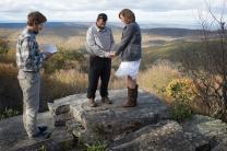 The Rev. Matt Hall conducts a renewal of wedding vows service for Nick and Stephanie Houle atop Sugar Run Mountain, just off the Appalachian Trail near Pearisburg, Va. Hall serves as a United Methodist chaplain appointed to the trail community. Photo by Mike DuBose, UMNS.