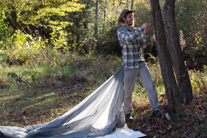 The Rev. Matt Hall puts up a tarp for shelter in the campground behind Trent's Grocery, just off the Appalachian Trail in Bland County, Va.