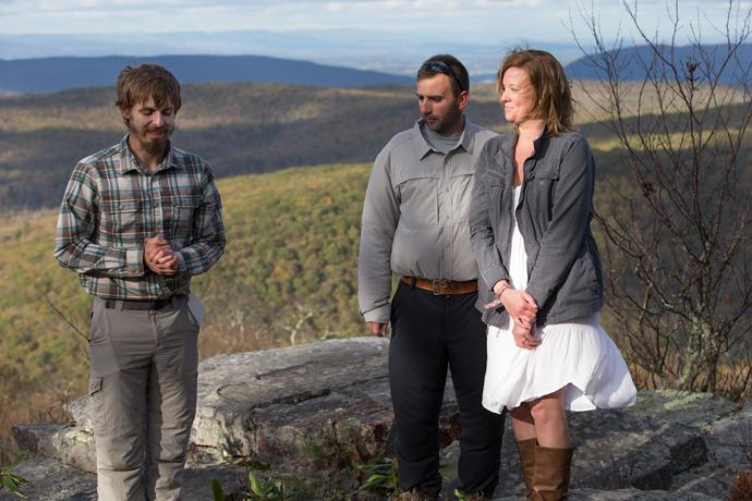 The Rev. Matt Hall (left) prays at a renewal of vows for Nick and Stephanie Houle on Sugar Run Mountain, just off the Appalachian Trail near Pearisburg, Va.