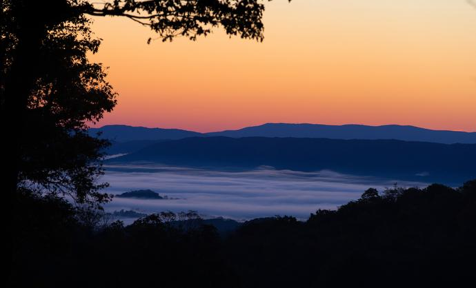 The sun rises over the fog-shrouded Shenandoah Valley just off the Appalachian Trail near Pearisburg, Va.