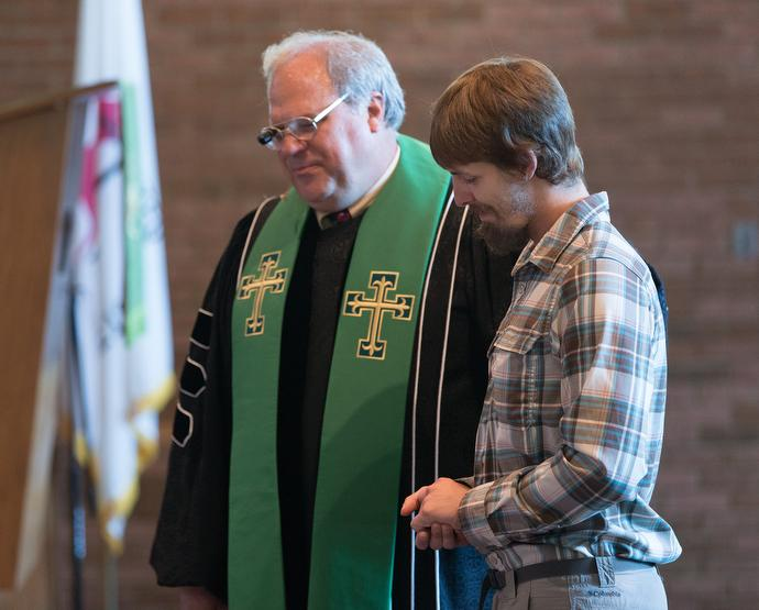 The Rev. Brian Burch (left) of First United Methodist Church in Pearisburg, Va., prays with the Rev. Matt Hall during worship at the church.