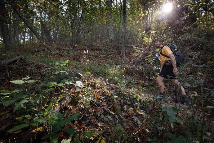 The Rev. Matt Hall hikes on the Appalachian Trail near Pearisburg, Va.