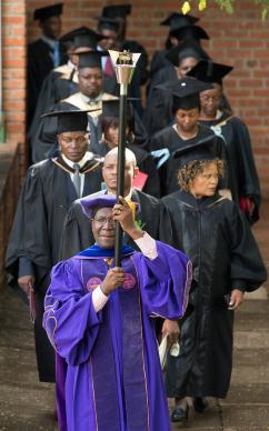 Mace bearer Walter Manyangarirwa leads the academic procession to open the 25th anniversary celebration for Africa University in Mutare, Zimbabwe. Manyangarirwa was a member of the first graduating class of the United Methodist institution. Photo by Mike DuBose, UMNS.