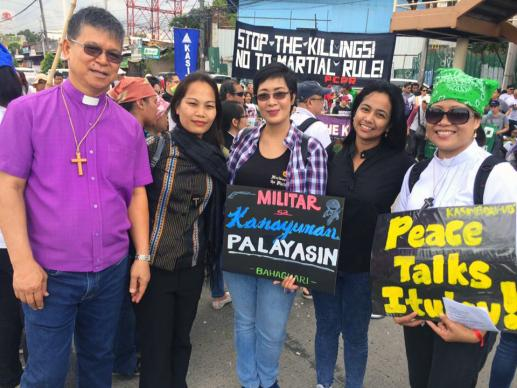 Manila Area Bishop Ciriaco Francisco (far left) and the Rev. Lizette Tapia-Raquel (center) were among those attending a demonstration on the day of Philippines President Rodrigo Duterte's State of the Nation address on July 24 in Manila. United Methodists have joined in demonstrations and calls for an end to martial law in Mindanao. Photo courtesy of Lizette Tapia-Raquel.