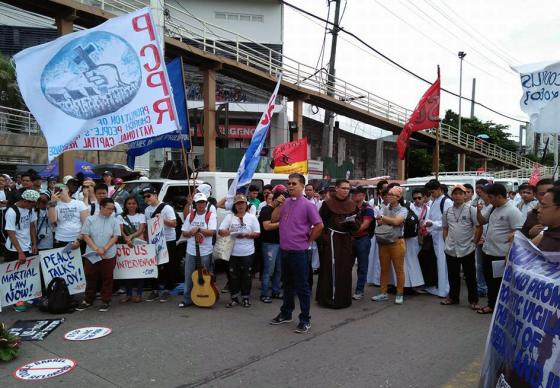 United Methodist Bishop Ciriaco Francisco speaks at a demonstration on the day of Philippines President Rodrigo Duterte's State of the Nation address on July 24 in Manila. Both Francisco and retired Bishop Solito K. Toquero denounced the extension of martial law in Mindanao. Photo by Sonny G. Dela Pena.