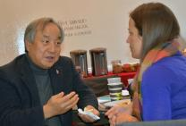 "Bishop Hee-Soo Jung speaks with Rebecca Cole, director of grassroots organizing at the United Methodist Board of Church and Society, at the three-day ""Peace on the Korean Peninsula"" seminar held at the United Methodist Building in Washington, Nov. 13-15. Korean-American United Methodists added their voices to the growing number of people calling on the U.S. government to tone down the rhetoric on North Korea. Photo by Erik Alsgaard, the Baltimore-Washington Conference."