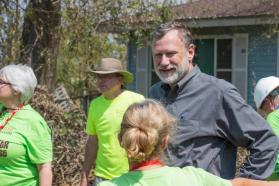 Bishop Robert Schnase of the Rio Texas Annual Conference visited Sept. 1 with community members and relief workers in areas heavily damaged by Hurricane Harvey. Schnase toured churches damaged by the storm, and met with emergency response teams, pastors and homeowners. Photo courtesy of the Rio Texas Conference.