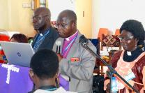 "United Methodist Bishop John K. Yambasu, surrounded by his cabinet, reads from his episcopal speech March 8-12 in Makeni, Sierra Leone. In his speech, Yambasu delivered a ""wake-up call"" to the Sierra Leone Annual Conference about the possibility of a global church split in 2020. Photo by Phileas Jusu, UMNS."