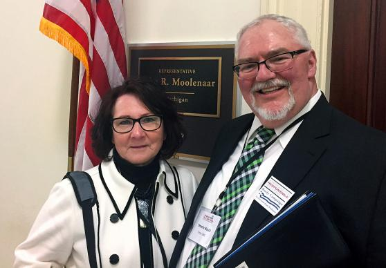 Chris Schwind, left, and her husband, the Rev. Tim Woycik, stand outside the office of Republican Rep. John Moolenaar of Michigan. The United Methodist couple drove 600 miles to Washington, D.C., to share the story of their daughter's murder as part of a summit on gun violence sponsored by the Brady Campaign to End Gun Violence and Americans for Responsible Solutions. Photo by Erik Alsgaard, UMNS.