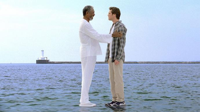 Morgan Freeman (left) as God tries to convince Jim Carrey that he is now all powerful in this scene from Bruce Almighty (2003). Press photo courtesy of Universal Pictures