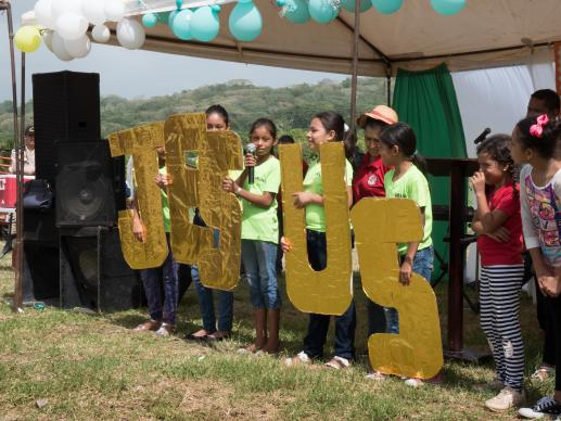 Children sang and read scripture behind large letters spelling out Jesus as part of the celebration of placing the cornerstone for Casa de Paz United Methodist Church. Photo by Kathy L. Gilbert, UMNS.