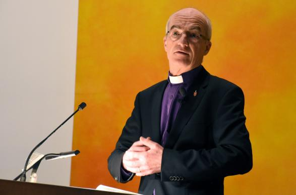 Bishop Patrick Streiff gives his episcopal address to the 2017 Central Conference of Central and Southern Europe, held March 8-12 in Zurich. Streiff emphasized the why and how of evangelism, as elaborated by Methodism founder John Wesley. Photo by Üllas Tankler, Global Ministries.