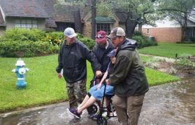 The Rev. John Stephens, senior pastor of Chapelwood United Methodist Church in Houston, (left) and the Rev. Josef Klam, directing pastor of Adult Discipleship at Chapelwood, (right), assist with a rescue during Hurricane Harvey. Photo courtesy of Chapelwood United Methodist Church.