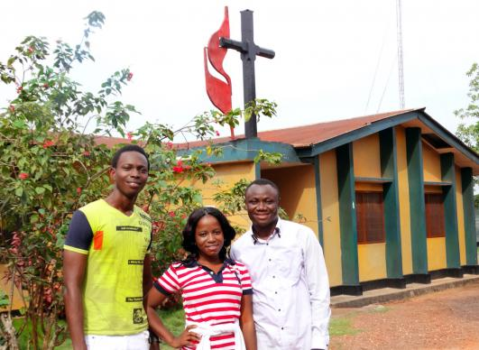 Johannes Baun (from left), Rose Saffa and Mohamed Nabieu, who were helped at the Child Rescue Center, are giving back the help they received by working at the center. The rescue center was founded to care for children impoverished by the 1991-2002 Sierra Leone civil war. Photo by Phileas Jusu, UMNS.