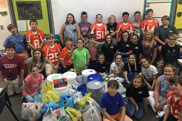 Fifth- and sixth-graders at Monroe Academy donate supplies for a relief bucket drive sponsored by First United Methodist Church in Monroeville, Ala. Photo courtesy of Alabama-West Florida Conference.
