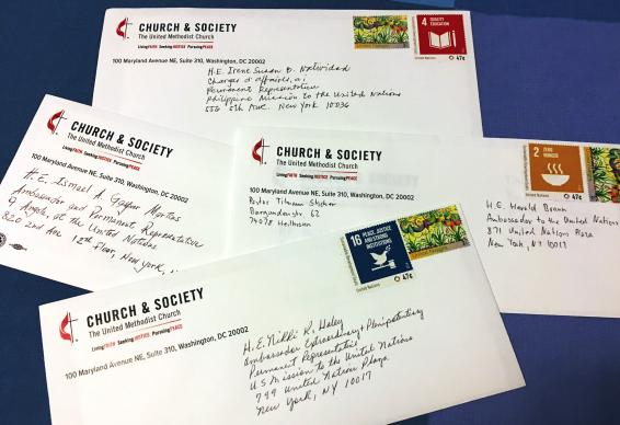 During a March 24 meeting at the Church Center for the U.N., directors of the United Methodist Board of Church and Society wrote letters to their ambassadors, urging support for the U.N.'s Sustainable Development Goals. Ambassadors receiving letters included representatives of the U.S., Angola, the Philippines and Germany to the UN. Photo by Levi Bautista, GBCS