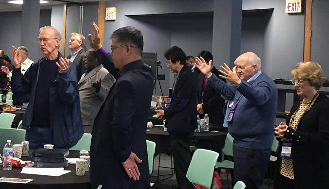 Bishops pray for the Holy Spirit's guidance during worship Nov. 8 at the Council of Bishops meeting at Lake Junaluska, N.C. Photo by Heather Hahn, UMNS.