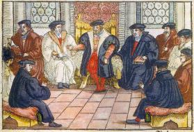 By invitation of the Landgrave Philipp of Hesse, Martin Luther and Ulrich Zwingli came to Marburg, Germany, in September of 1529. Some of their followers also attended. Anonymous woodcarving dating to 1557, courtesy of Wikimedia Commons.
