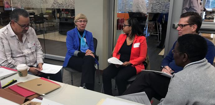 The Rev. Jorge Acevedo (left), Alice Williams, the Rev. Jasmine Smothers, the Rev. Tom Lambrecht and Mazvita Machinga talk together during the first meeting of the Commission on a Way Forward in Atlanta, Jan. 23-26. Photo by Diane Degnan, United Methodist Communications