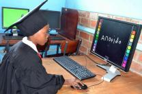Anotida Kadiramwando writes her name on the computer at Murewa Day Care Centre in Zimbabwe. A program, sponsored by The United Methodist Church in collaboration with the Ministry of Primary and Secondary Education in Zimbabwe, aims to have computer laboratories at all United Methodist-run schools in Zimbabwe by 2025. Photo by Kudzai Chingwe, UMNS.