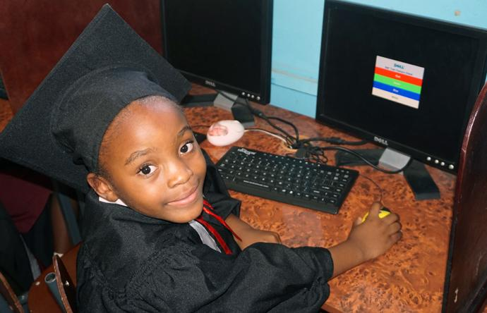 Six-year-old Charlene Ramaboea shows off her computer skills at the Murehwa Day Care Centre in Mashonaland East province, Zimbabwe. Photo by Kudzai Chingwe, UMNS.