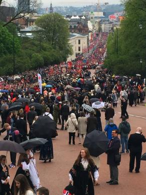 People, many waving Norwegian flags, fill the streets of central Oslo to watch the annual children's parade in celebration of Norway's National Day.  Photo by the Rev. Alfred T. Day III, top executive of the Commission on Archives and History.