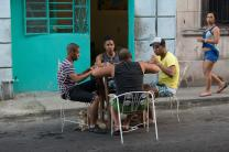 "Friends play dominoes at a table pulled into the street in Havana. ""Life here is very sociable,"" says Rigoberto Figueroa, — a member of Marianao Methodist Church and vice rector of the Havana seminary. Photo by Mike DuBose, UMNS."